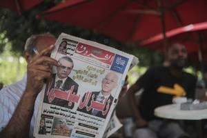 tunisia's presidential vote pits professor vs. prisoner