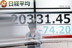 tokyo stocks close higher as market concerns ease