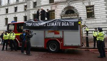 treasury sprayed with fake blood by extinction rebellion