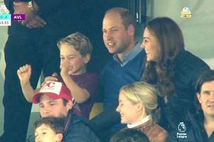 Prince George enjoying the Villa v Norwich game with his mum and dad, Duke and Duchess of Cambridge
