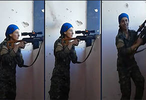 Female Kurdish Sniper Laughs After Nearly Getting Her Head Shot off