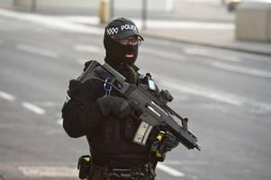 man arrested as armed police descend on street near co-op