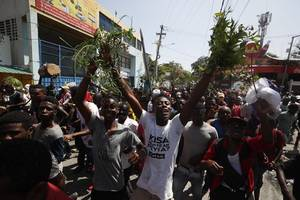 haiti protesters clash with police hours after journalist shot dead