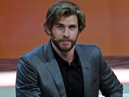 liam hemsworth pictured holding hands with mystery woman as he moves on from ex-wife miley cyrus