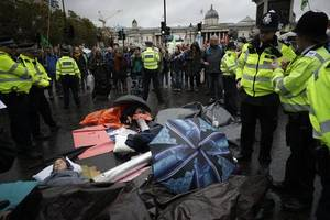 Extinction Rebellion arrests near 1,300 after London fish market protest