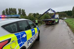 police close road as car crashes into ditch