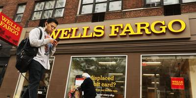 wells fargo posts earnings miss driven by $1.6 billion expense linked to scandals (wfc)