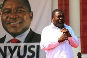 mozambique president praises peace, opposition warns in tense election