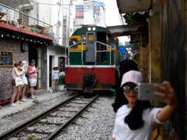 hanoi shut down its instagram-famous 'train street' cafes because they were overrun with selfie-taking tourists. here's how it got to this point.