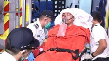 hong kong: protest leader left bleeding on street after brutal hammer attack