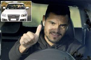sergio romero has huge grin on his face as he arrives for man utd training
