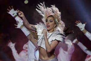 lady gaga suffers a gut-wrenching fall offstage during a dance with fan