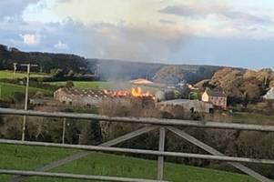 1,000 bales of hay are on fire in Truro - live updates