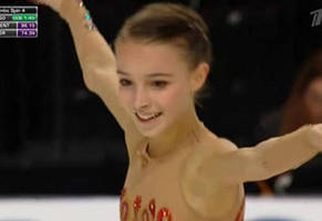 Russian Ice Skater Wows Crowd With Magical Costume Change