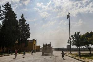 kurdish fighters withdraw from besieged syria town