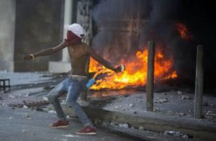 thousands protest against haiti's president
