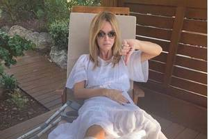 Amanda Holden has surgery after breaking her leg on inflatable assault course