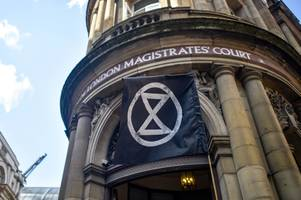 Three Extinction Rebellion protesters who glued themselves to office guilty after targeting coal firm