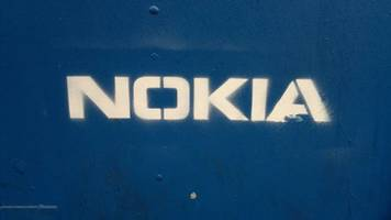 nokia cuts profit outlook citing tough competition