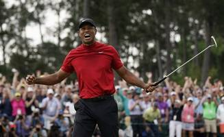 tiger woods leads in japan after second round of 64