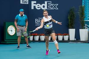 simona halep gets the better of bianca andreescu at wta finals