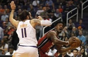 Butler, Dragic lead Heat over Suns 124-108