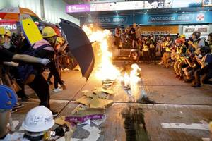 Hong Kong protests: Man set on fire in 'argument over national identity' on day of clashes