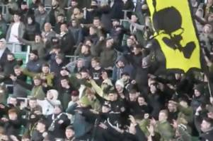 footage shows celtic fans booing green brigade as they chant 'stick your f***ing poppies up you a***'