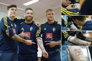 man utd star victor lindelof shows off art skills - by giving sweden fan a tattoo
