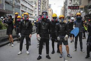 pro-democracy protesters bring hong kong to standstill for a fourth day