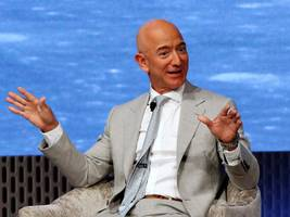 jeff bezos is reportedly interested in buying the seattle seahawks (amzn)