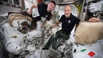 watch: astronauts take complex spacewalk to fix cosmic ray detector
