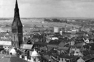 magnificent cathedral spire dominates fabulous 1950s panorama view of city
