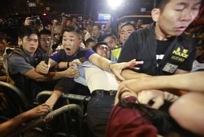 china pulls rank on hong kong court over face mask ruling