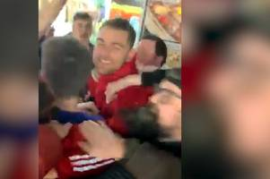 jubilant wales stars joe allen and sam vokes sing 'wales golf madrid' with fans in cardiff's famous chippy alley