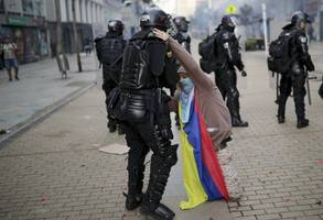 authorities impose curfew in capital of colombia, deploy 20k police against protesters