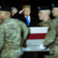 trump makes unscheduled visit to receive remains of two fallen soldiers