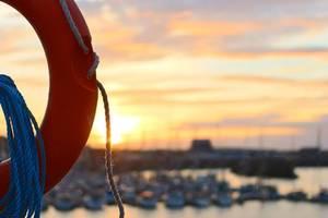 italian coast guard rescues 143 migrants from capsized boat