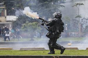 three colombia police killed in bombing after thousands gather for renewed protests