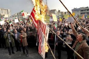 iranians rally en masse against 'rioting'
