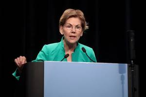 democrat warren accuses rival bloomberg of trying to buy us presidential election