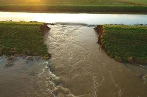 up to 200 acres of farmland underwater as farm is evacuated after river bursts its banks