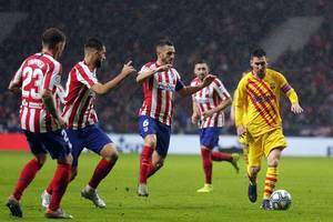late messi magic sees barca beat atletico