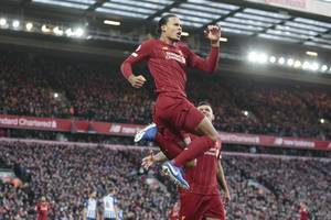 liverpool 11 points clear despite alisson red as van dijk sinks brighton