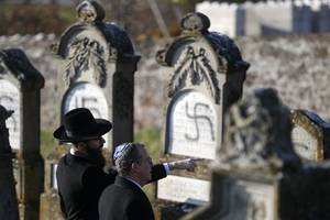 swastikas sprayed on more than 100 graves in jewish cemetery in france