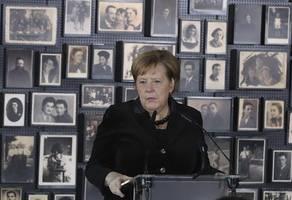 germany's merkel begins her first ever visit to auschwitz