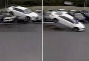 driver loses control & perfectly flies over a dozen cars... before smashing into others