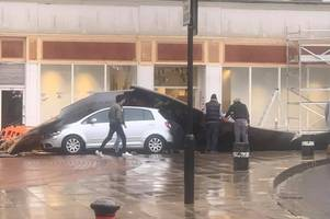 storm atiyah: strong winds tear down hoarding which falls onto car in town centre
