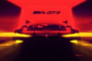 teaser for bmw m4 race car hints at huge grille