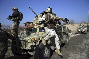 afghan blasts kill one, injure scores in attack on key u.s. military base